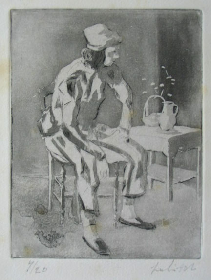 Young Man Sitting on a Chair
